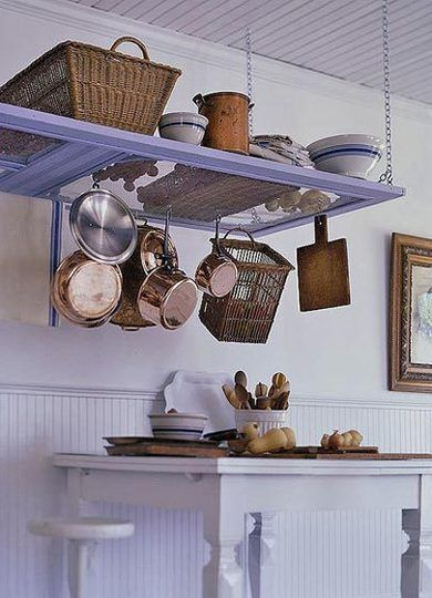 Kitchen door converted into pot rack